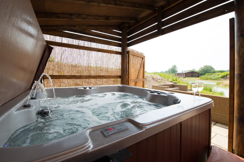 Stunning romantic luxurious lakeside log cabin for Hot tub shelters