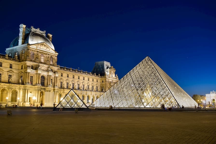 View of The Louvre in Paris light up at night