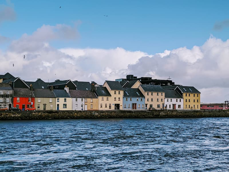Row of colourful terrace fisherman cottages in Galway, Ireland