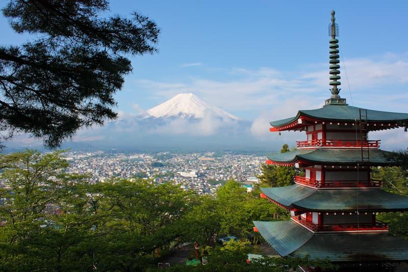A rRed pagoda in Fujiyoshida, Japan with views overlooking Mt Fuji